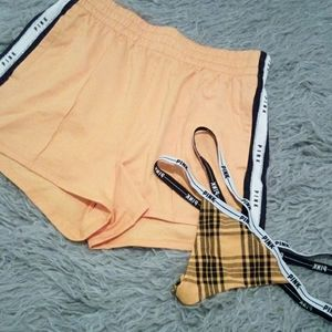 Yellow track shorts with strappy thong